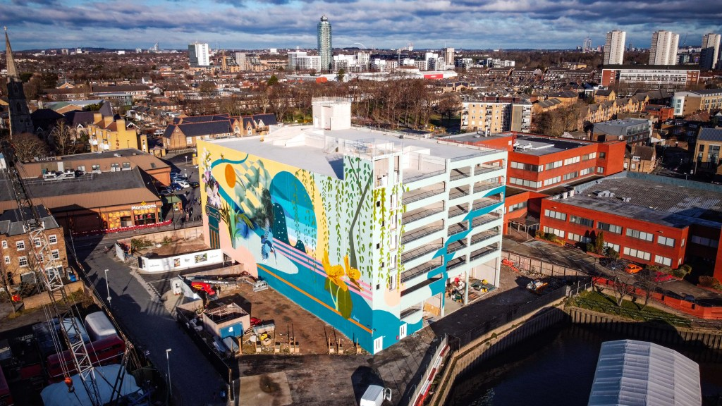 Large scale mural in Brentford on the side of car park by Jo Hicks aka Hixxy