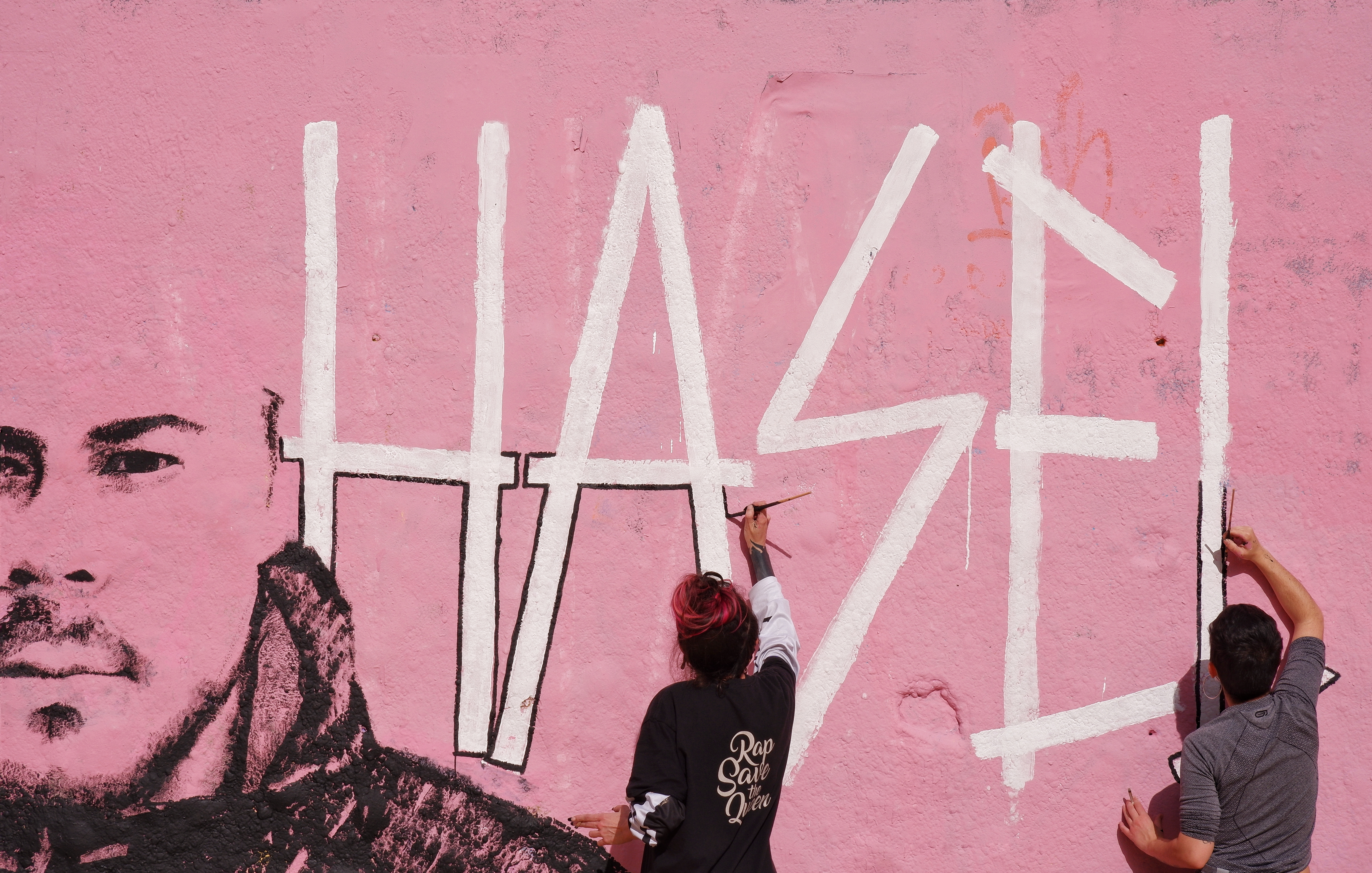 Artists paint a mural tribute to Pablo Hasel