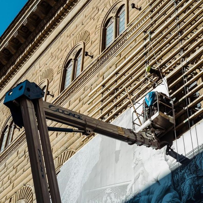 JR installing La Ferita on the Palazzo Strozzi in Florence
