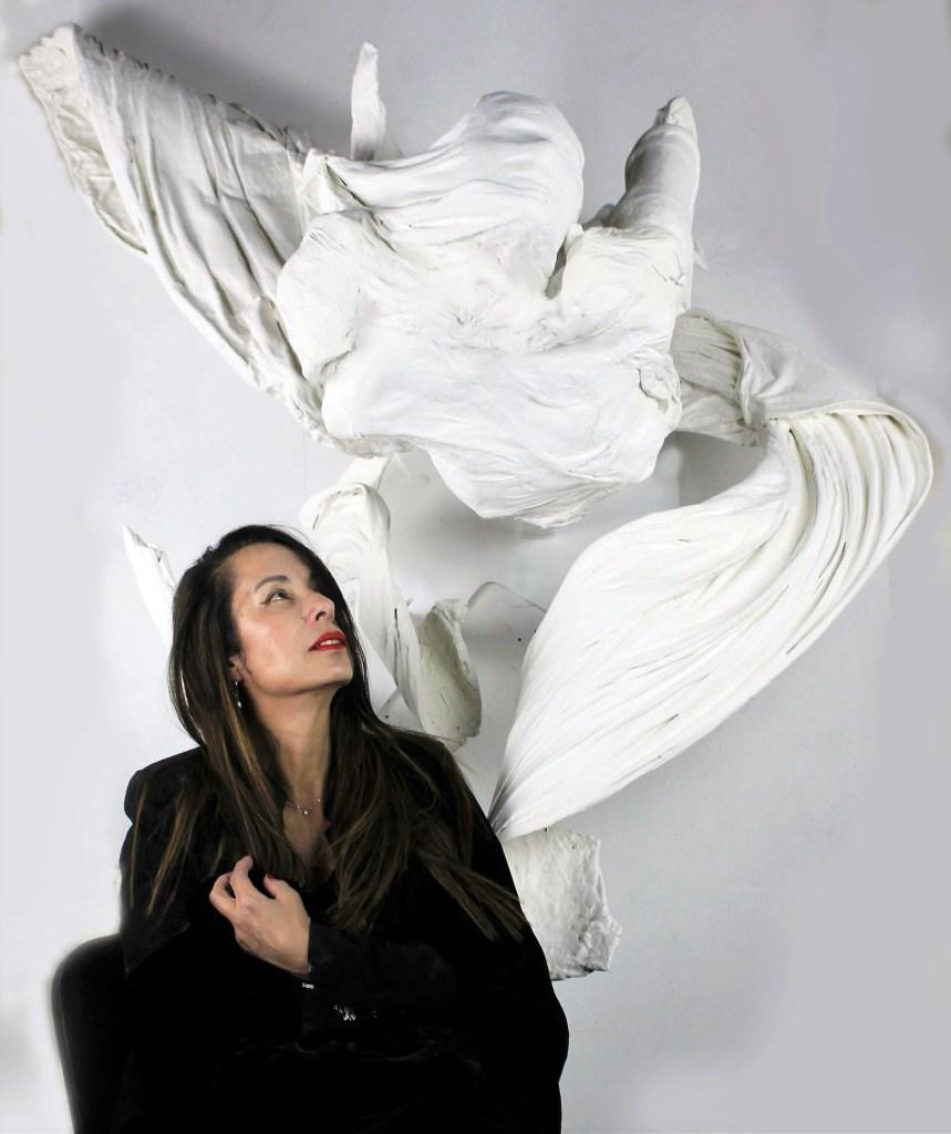 Jasmine Pradissitto pictured with her sculpture 'Breathe'