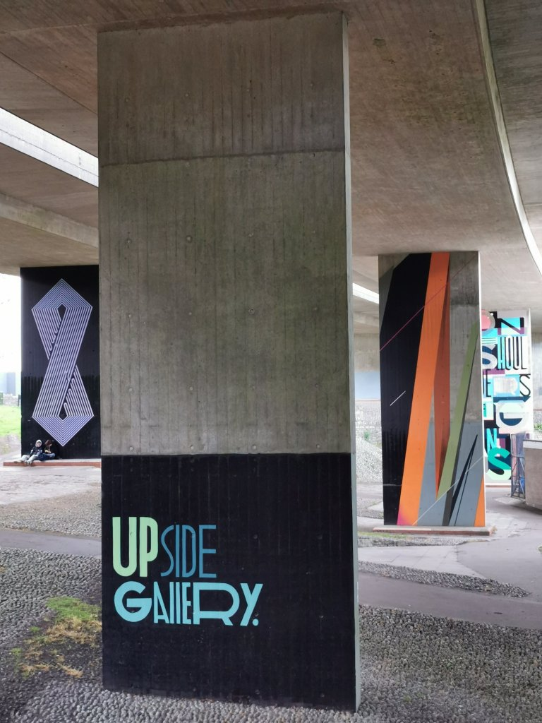 Logo of the Upside Gallery in the Central Gardens in Bournemouth