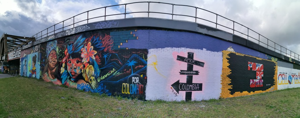 Wall showing murals in solidarity with Colombia in Shoreditch