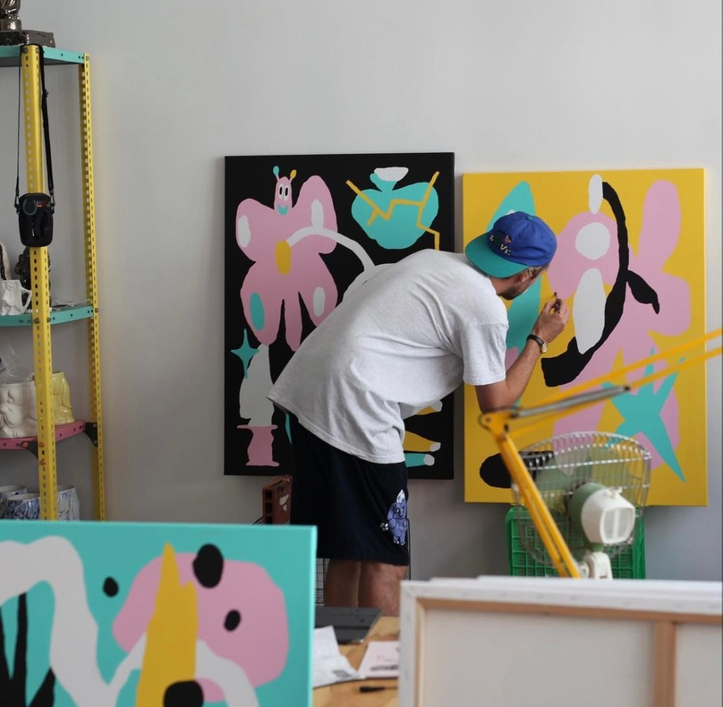 Artist Malarko painting canvasses in preparation for his Flomper exhibition at BSMT Space