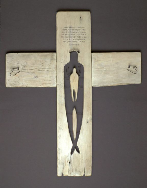 Sculpture of Christ on the cross revealing the believer positioned within Christ