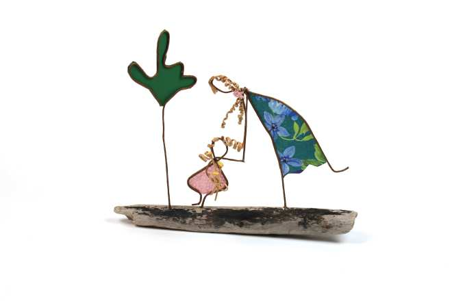 Image of Dandelions for Mom, a sculpture in wire and cut paper on driftwood.