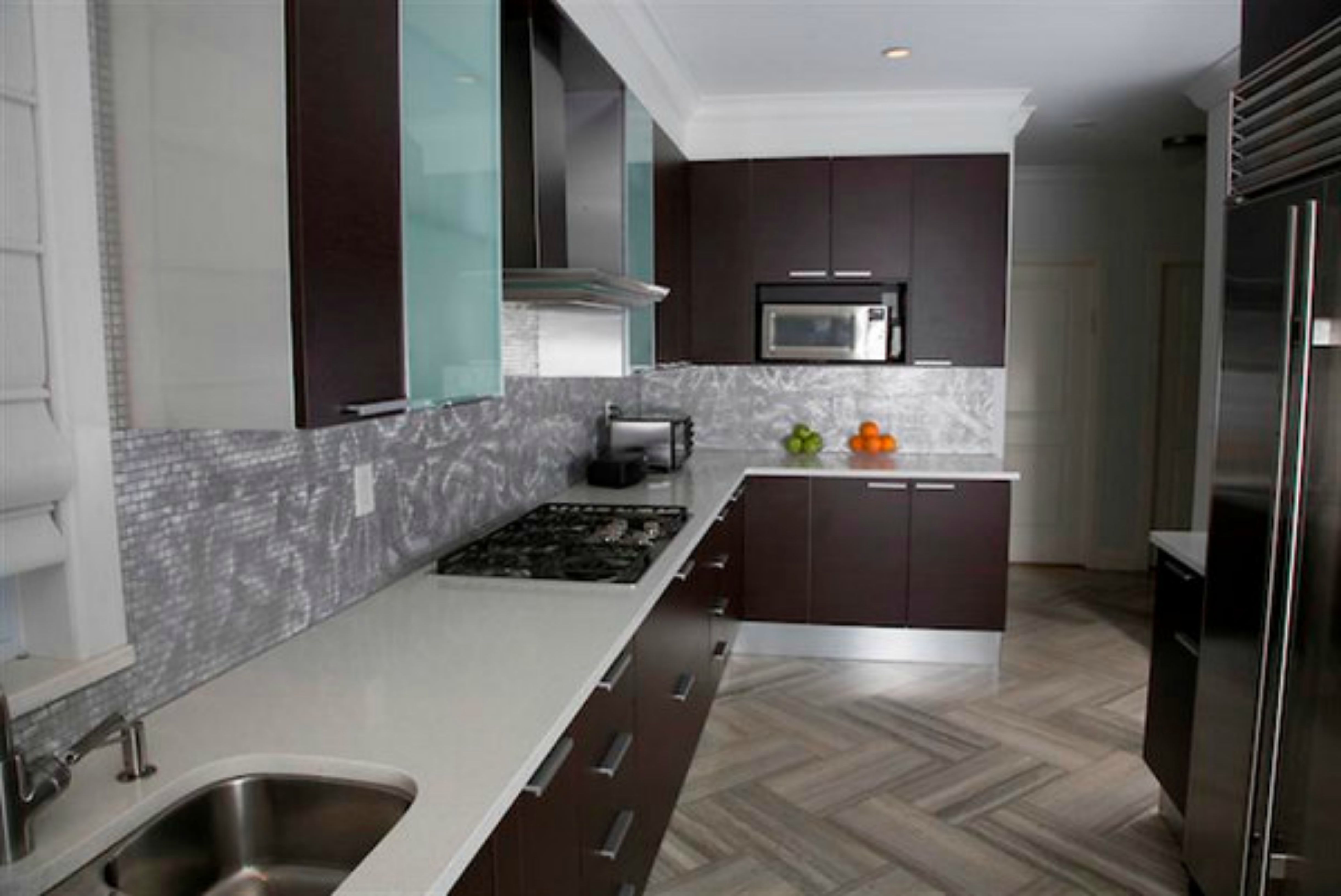 chevron floor with silver waterfall tile backsplash picm