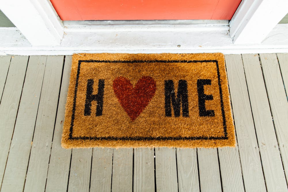 welcome home mat in front of door