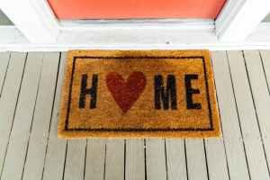 welcome home mat in front of door