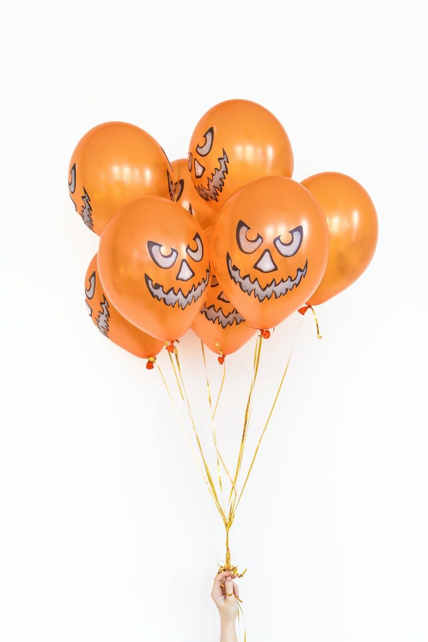 orange balloons on white background