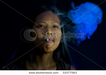 stock photo thai indian woman smoking in dark room