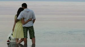 stock-footage-lovers-couple-watching-the-sea-and-enjoying-the-time-together