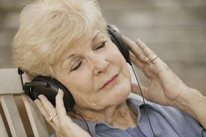 Senior Woman Listening to Headphones