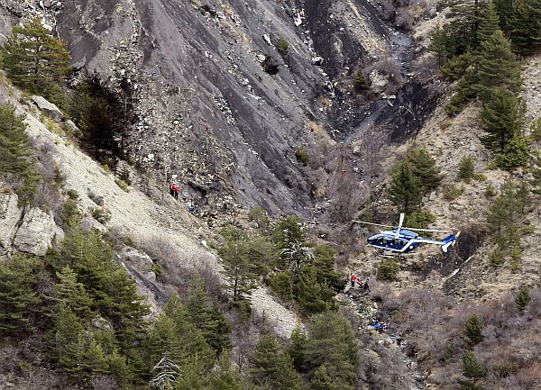 A French gendarme helicopter flies over the crash site of an Airbus A320, near Seyne-les-Alpes