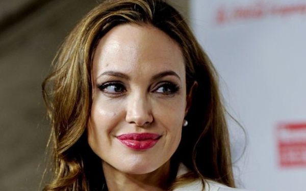 "Angelina Jolie...FILE - This March 8, 2012 file photo shows actress Angelina Jolie at the Women in the World Summit in New York. Jolie says that she has had a preventive double mastectomy after learning she carried a gene that made it extremely likely she would get breast cancer. The Oscar-winning actress and partner to Brad Pitt made the announcement in an op-ed she authored for Tuesday's New York Times under the headline, ""My Medical Choice."" She writes that between early February and late April she completed three months of surgical procedures to remove both breasts. (AP Photo/Evan Agostini, file)"