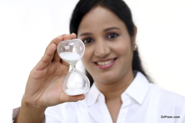 Business woman holding hourglass