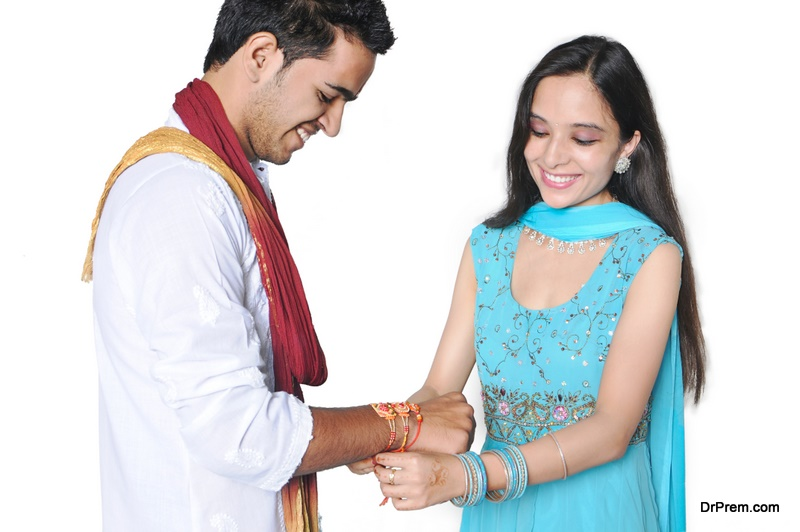 Sister tying Rakhi on her brother's wrist