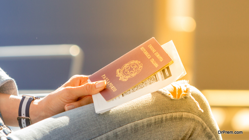 woman holding Italian passport