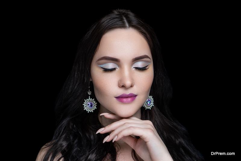 woman wearing massive round shape earrings