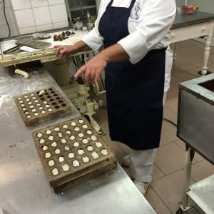 Preparing chocolates at Romanengo Laboratory in Genova on Instantly Italy
