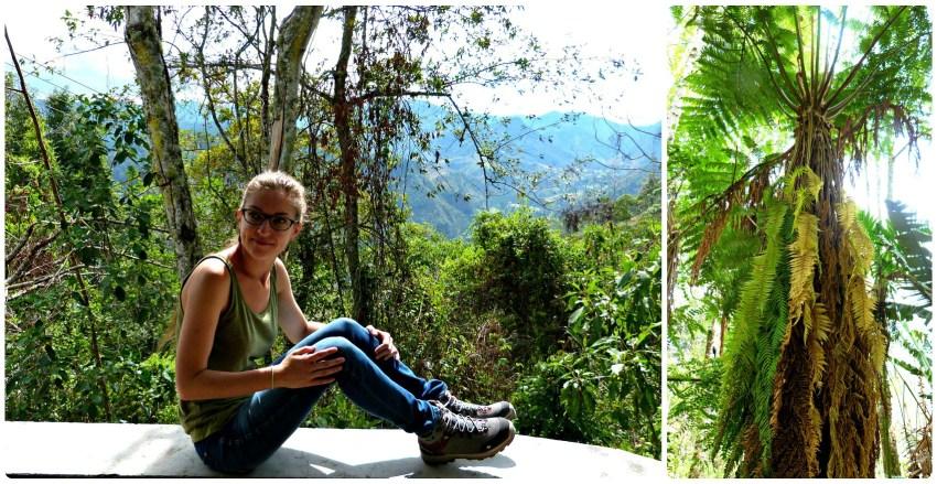 Charlène sentado en un muro con una vista sobre el valle de Salento