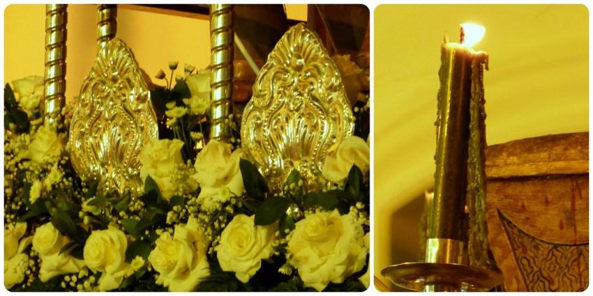 Zoom en las flores y las velas de un paso del martes santo durante el desfile de la Semana Santa de Popayán