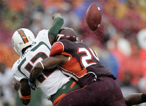 Virginia Tech DB Dorian Porch sacked Jacory Harris and forced him to fumble early in the first quarter, marking the start of a long day for the Miami quarterback. (AP Photo/Steve Helber)