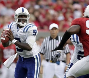Duke quarterback Thaddeus Lewis accounted for six touchdowns in a 49-28 win at N.C. State Saturday. (The Associated Press)