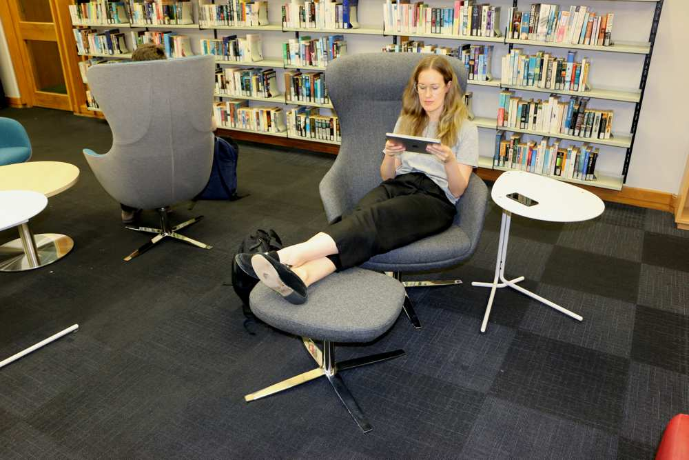 Put your feet up with ELIZABETH Chair and foot stool, at Massey University.