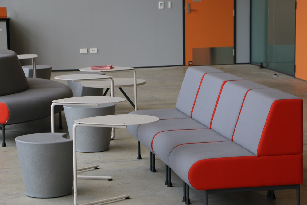 APPLE Stools form an informal area, at Waikato University's Law and Management Building.