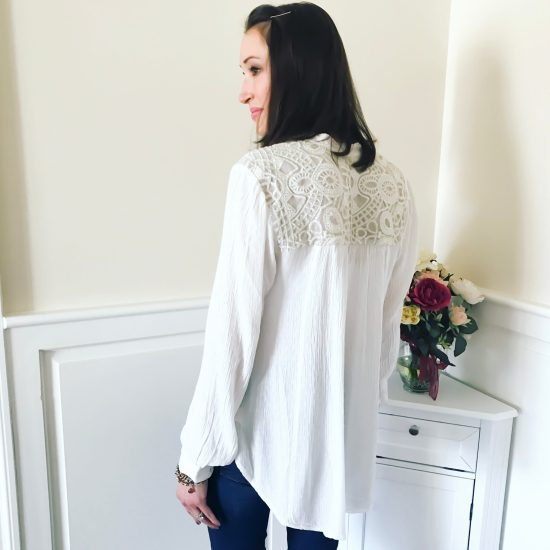 early spring outfit ideas- free people blouse and bootcut jeans