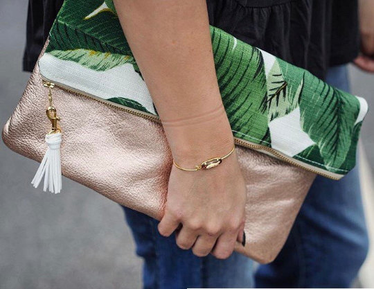 palm print and rose gold clutch