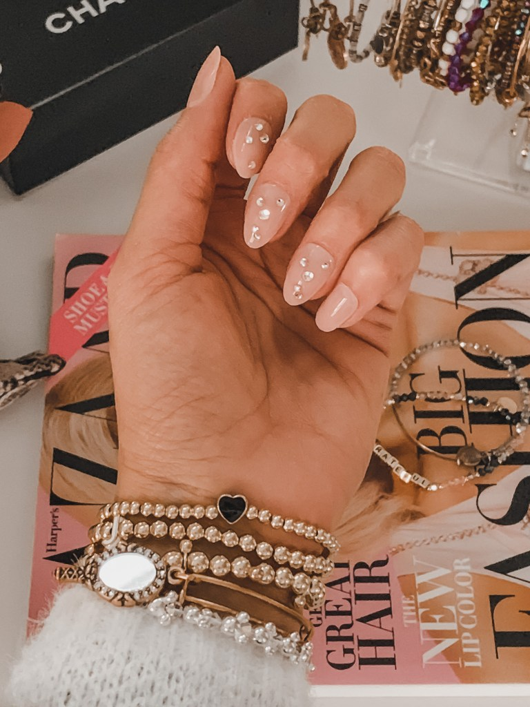 almond-shaped, nude colored nails