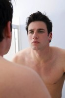 Man_looking_at_his_reflection_15697124.jpg