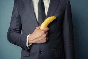man-in-suit-holding-a-banana.jpg