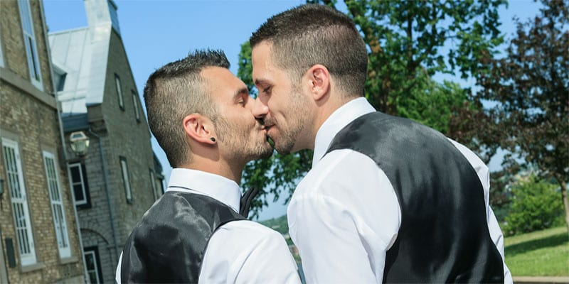 Photo of a gay couple kissing after getting married (photo: Depositphotos)