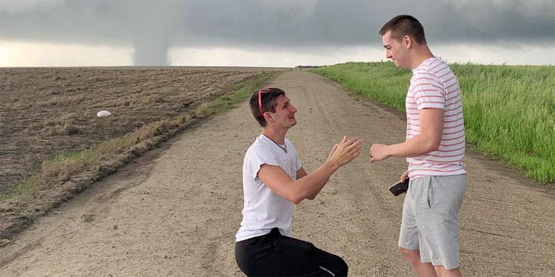 Joey Krastel pops the question to bf Chris Scott during Kansas tornado (image via Twitter)