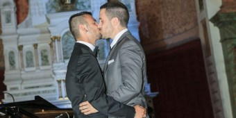 Two gay men celebrate their wedding