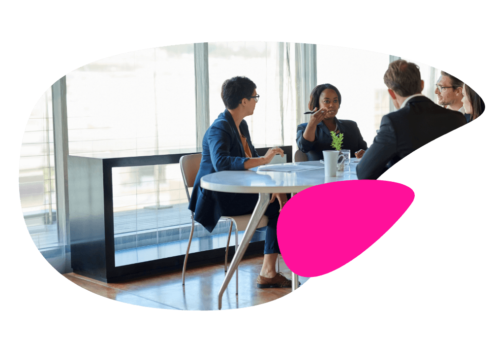 Image of a woman leading a business discussion with her peers on how to protect and grow a small business in Connecticut.