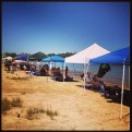 Shade tents line Granite Beach shoreline.