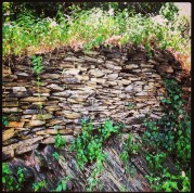Beautiful horizontal slate rock wall sitting atop slate bed rock.