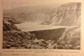 Brush Dam, North Bloomfield Company, For impounding tailings. Dam is in the washed-out ground. It is sixty-five feet high and is raised as the tailings accumulate. The impounded tailings may be seen in the artotype. Nevada City c. 1890