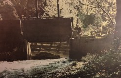 Campbell Creek diversion into the flume and water pipe carried by the suspension bridge to hydraulic mining activity near Salyer, CA,