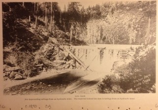 Log Dam for impounding tailings from a hydraulic mine. The material behind the dam is tailings from a hydraulic mine. c 1890 Upper Slate Creek.