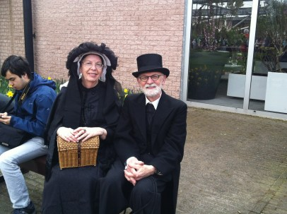 Smart Dutch lady and gent in old-fashioned clothes at the Keukenhof