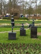 Statues of women at the Keukenhof