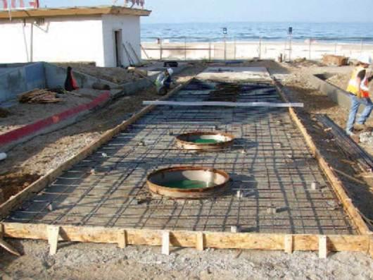 Malibu beach installation of below-grade wastewater tanks