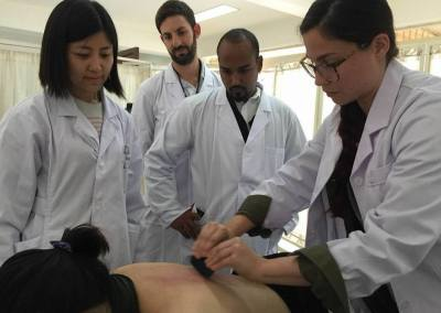 Acupuncture in Coral Springs DRs Training Scraping in China