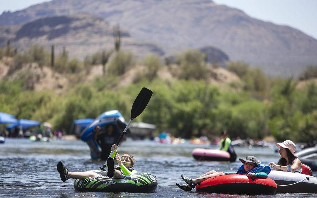 Tubers and kayakers enjoy the Salt River in the Tonto National Forest