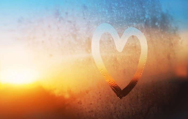 A heart outlined on a frosted window