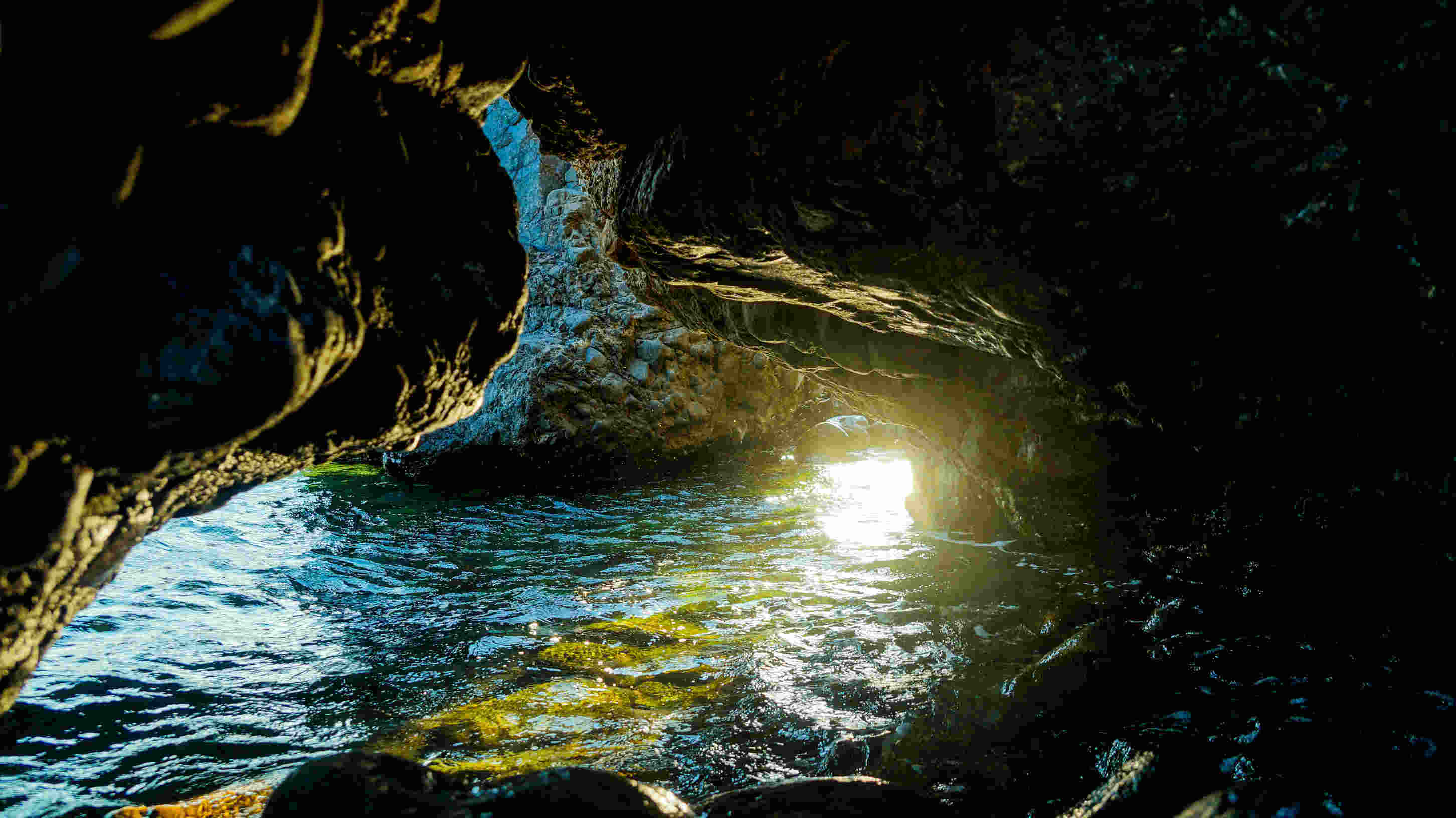 dark cave with sea flowing
